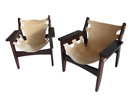 pair of kilin armchairs in stitched soft leather and brazilian rosewood sergio rodrigues c