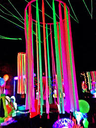 Neon flagging tape on hulla hoop, glow party decoration Fnid more festival,  rave and