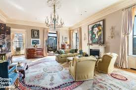 another look at the elegant living room featuring its classy furniture set chandelier and a