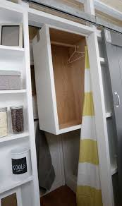 diy closet that slides away into shower for a tiny house designed and built by ana white