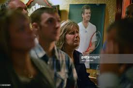 supporters from andy murray s home town cheer him on during the us fans of tennis player andy murray react as they watch his us open men s singles final