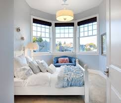 blue is just as precious for a s room when the accessories lean toward the feminine and romantic here soft blue walls bathe the walls in pastel