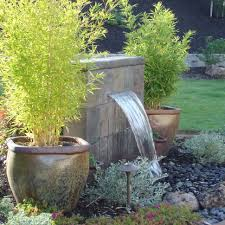 outdoor garden fountain. Outdoor , Extravagant Modern Fountain For Enhancing Your Garden\u0027s Beauty : Stone Between The Garden U