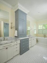 two tone bathroom cabinets with marble basketweave tiles