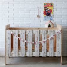 rustic crib furniture. Unusual Details For Rustic Diy Baby Crib With Maple Material And Tiny Circus Flag Ornaments Near White Exposed Brick Wall On Concrete Flooring Furniture D