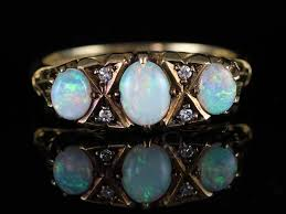 stunning inspired victorian antique ring this inspired victorian antique opal ring is 9 carat gold the opals are wonderful bright and lively