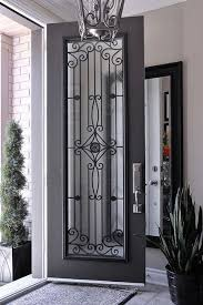 black iron door with a wrought insert