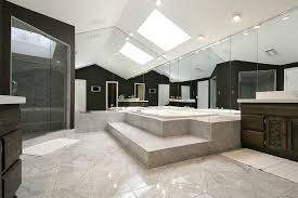 big bathroom designs. This Stunning Bathroom Features Glossy Squares Of Stone Tile, Soaring Ceilings, And Wall Length Big Designs