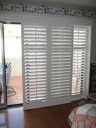 sliding patio door built in blind combined with brown hardwood floor white