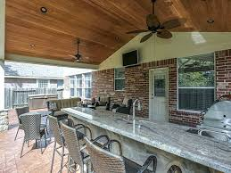 outdoor covered patio with outdoor kitchen in