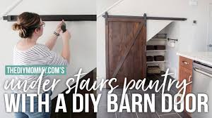 build an under stairs pantry with a sliding barn door the diy mommy