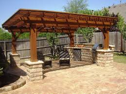 exterior enthralling outdoor covered patio designs with cozy pergola ideas brown wicker chairs also metal kitchen