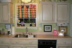 colorful window curtain in rustic kitchen with white painting old kitchen cabinets and glossy sink