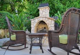 rustic outdoor fireplace made from stone