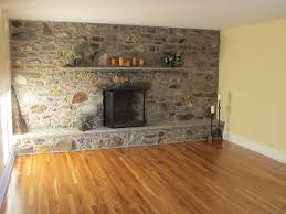 Great Brown Wooden Floors Installations With Grey Wall Stones Added  Floating Shelves Over Fireplace Hearth Ideas In Rustic Interior Designs