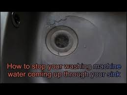 how to fix water coming up through your sink from the washing laundry machine dishwasher
