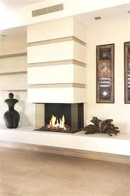 3 sided gas fireplace contemporary gas fireplace with traditional touches such as a pile of timbers 3 sided gas fireplace