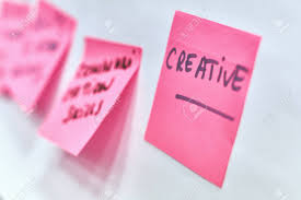 Creative Written On Pink Paper Stickers Attached To A Flip Chart