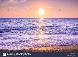Purple Landscape With Sea And Sunset Evening Sun Over Ocean
