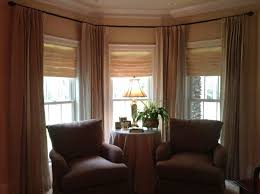 corner window curtain rods make home looks beautiful modern armchairs with table lamp and bay