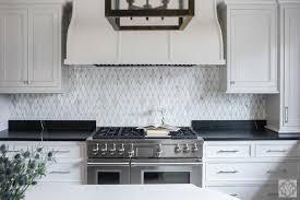 soapstone kitchen countertops with white marble diamond pattern tiles