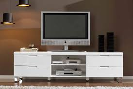 White Wooden Tv Stand With Two Shelves On The Middle Of Drawers Also Silver  Steel Legs