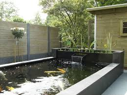 Modern garden pond with decked bench seat - cantilevered benches would have  been the next level of conceptualisation, but the struts are fairly eas