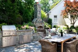 stone outdoor kitchen fireplace outdoor fireplace botanical decorators olney md