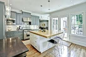 grey butcher block countertops traditional kitchen with gray cabinets white island subway tile and wood