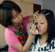 armed with an economics degree from university ms christine yong could have settled for a cushy make up artist picture makeup artist jobs