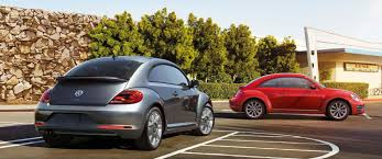 2018 volkswagen beetle colors. delighful beetle two beetle models in a parking lot on 2018 volkswagen beetle colors