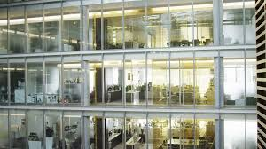 contemporary office building. 4k / Ultra HD Version High Angle View Looking Down On Business People Walking Through Large Contemporary Office Building