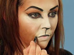 painting cat makeup for halloween