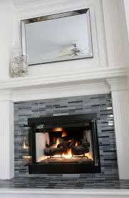 updated fireplace grey black glass tile decor tile fireplace more