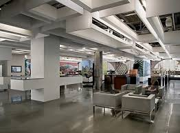 google office space design. autodesk offices have large open spaces featuring an industrial design supported by a cool shiny concrete floor google office space