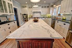 light color marble countertops kitchen island with dark cabinets and dark granite countertop with
