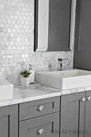 formica 180fx calacatta marble laminate countertop hexagon mosaic marble backsplash and chelse gray vanity in ensuite bathroom with raised sinks by kylie m