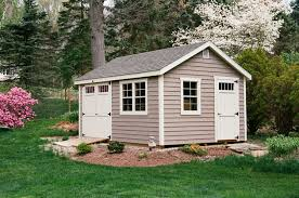 angle showing 3 single door with transom window upgraded miratec trim 6 overhangs a beautiful garden shed