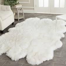 faux animal rug spectacular white sheepskin plus armchair on grey ceramic tiled interior design 7