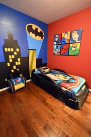 boy s batman superhero themed room with bat signal over the city wall mural batmobile bed