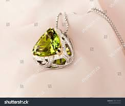 stock photo white gold pendant with peridot and diamonds 1281132349