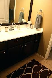 painted the walls resurfaced cultured marble to a plain white replaced faucets and light fixtures framed painting countertops how refinish vanity top cultur