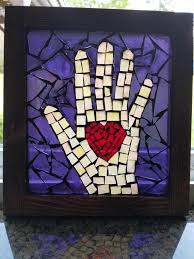 heart in hand stained glass mosaic wall