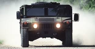 u s defense am general hmmwv driving directly at viewed on gravel road