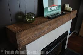 even a simple faux wood beam as a fireplace mantel can give a room that finishing