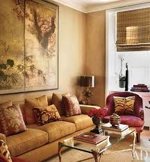 gold living room furniture. below a japanese screen in the media room is sofa by jasper covered gold living furniture