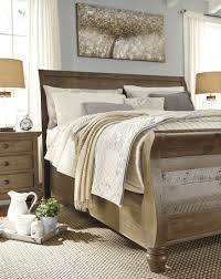 trishley light brown king sleigh bed media gallery 1
