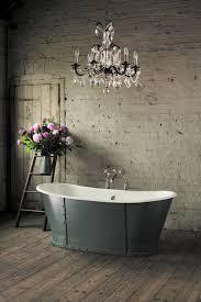 bathroom chandeliers crystals over tub in a rustic bathroom interior design full size