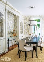 the condo s beautiful crown moldings the homeowners on first viewing modern white leather dining chairs keep the dining e from feeling too