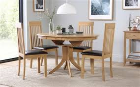 hudson round oak extending dining table with 6 oxford light chairs